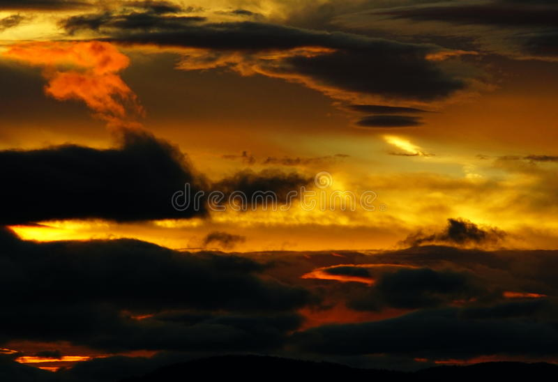 Fire sunset, dusk, evening Looking toward Bear Mountain. Fire sunset, dusk, evening Looking toward Bear Mountain from Mount Tolmi Victoria British Columbia stock images