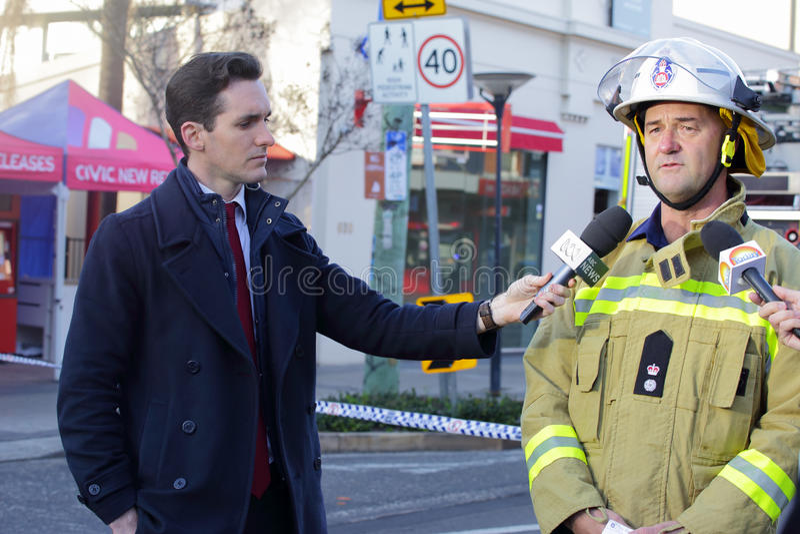 Fire Superintendent Paul Johnstone updating media. ROZELLE, AUSTRALIA - SEPTEMBER 4, 2014; Superintendent Paul Jonstone of Fire and Rescue updating media on fire royalty free stock photo