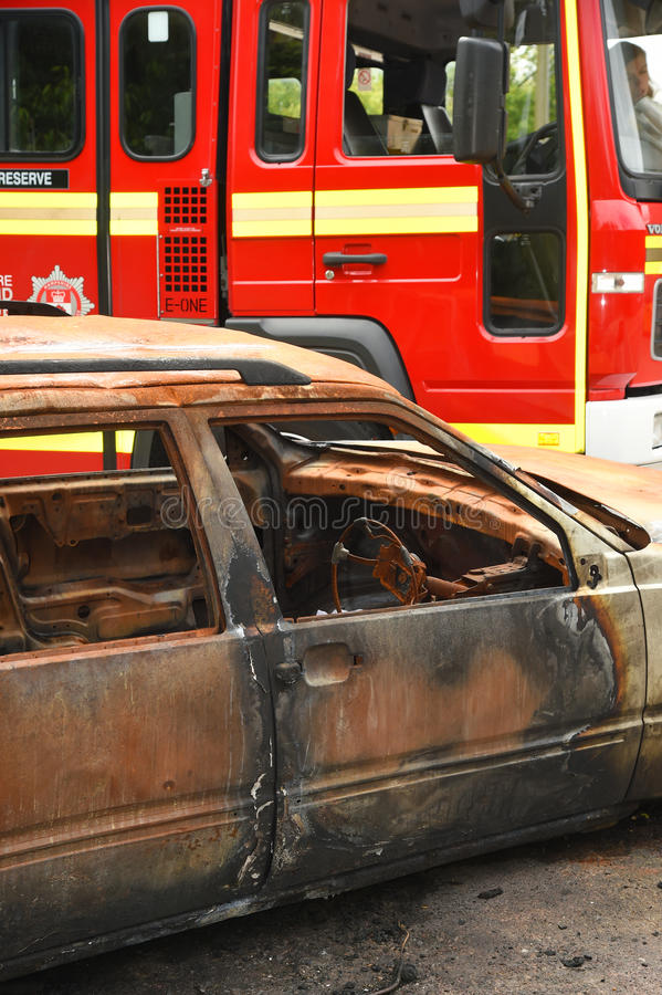 Fire tender at a car fire royalty free stock photo