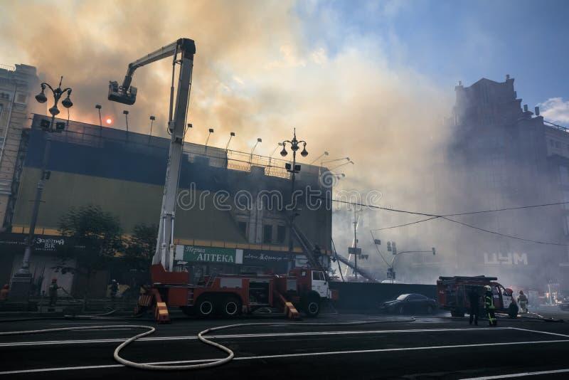 Fire in a three-story house in Kiev. KIEV, UKRAINE - Jun 20, 2017: Ukrainian firefighters try to extinguish a fire in a three-story house on Khreshatyk street royalty free stock photos