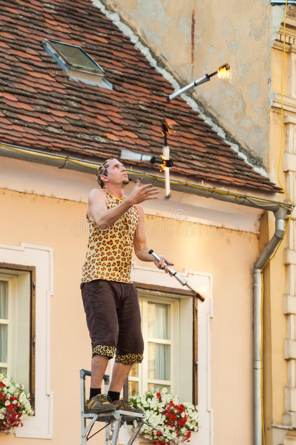 Fire torch juggler performing during Spancirfest festival. In Varazdin, Croatia. It is street festival held every year since 1999 and lasts for 10 days, hosting stock image