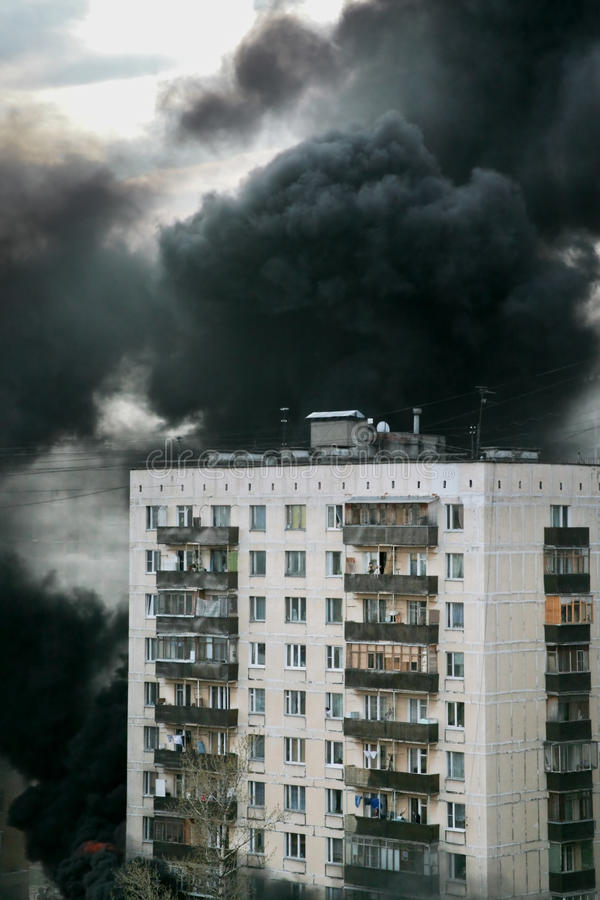 Fire in town. Black smoke and fire in town stock photography