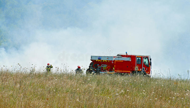 Fire truck. And fireman in a fied royalty free stock photography