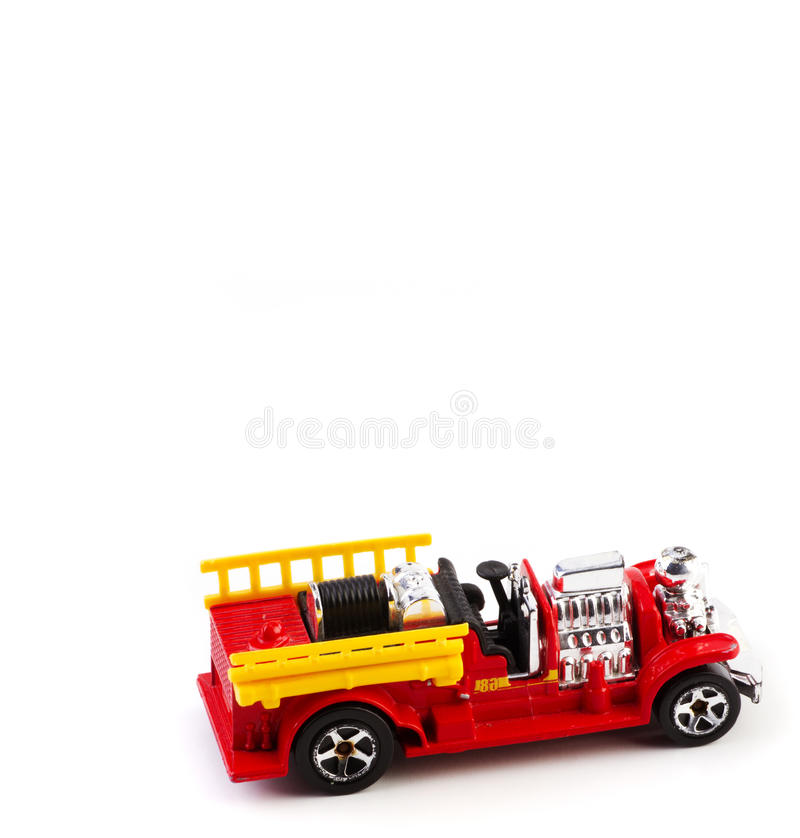 Fire truck. Toy fire truck isolated on a white background royalty free stock images