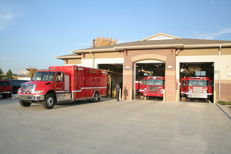 Fire truck. In front of fire house stock images