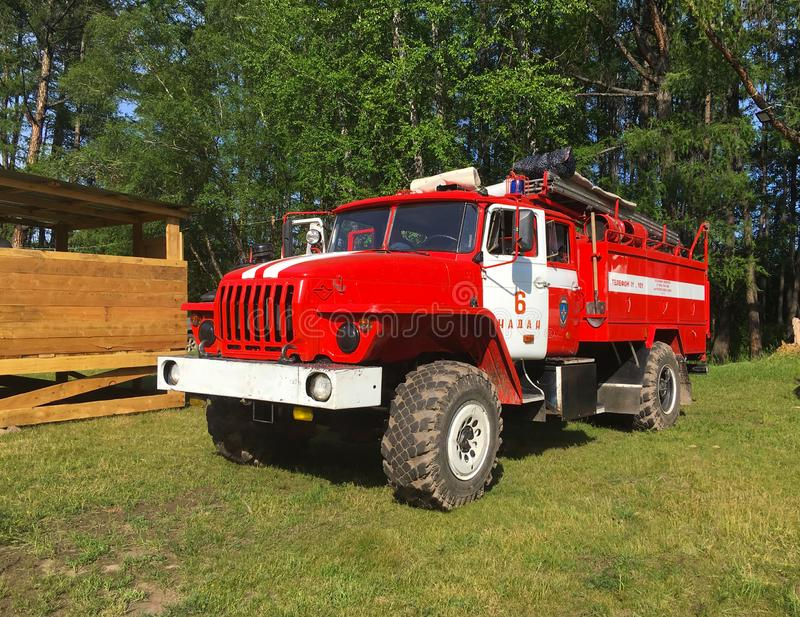 Fire truck on duty. Chadan, Tuva Republic, Russia - July 4, 2019: Red fire truck on duty at the countryside. Service to ensure fire safety at the summer music royalty free stock photography