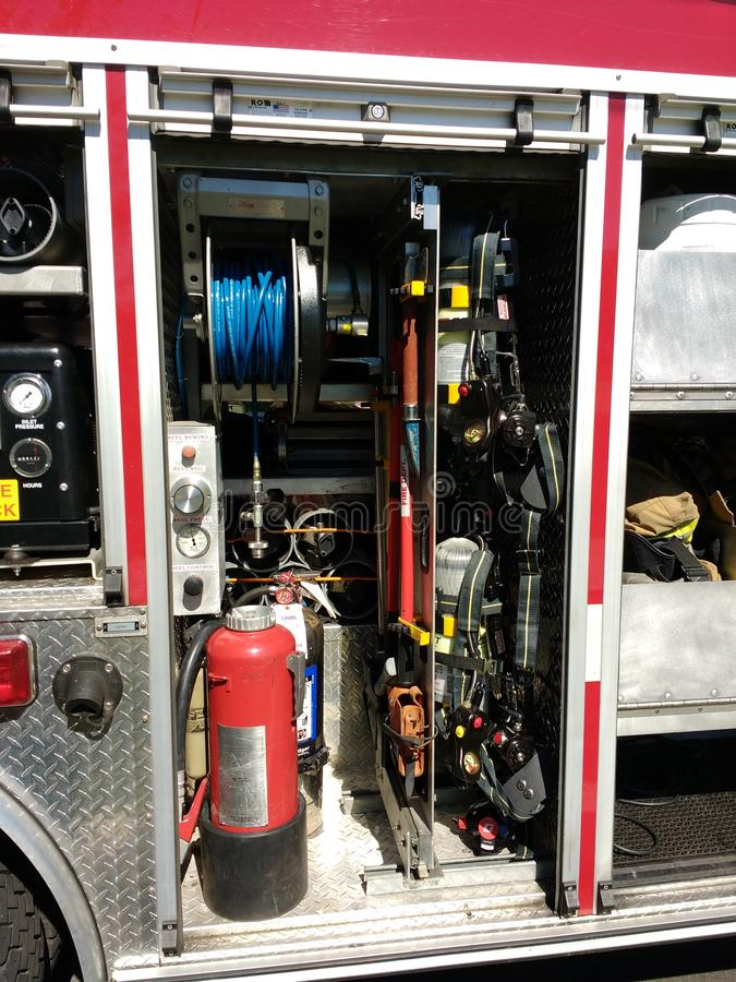 Fire Truck With Firefighting Equipment, Rutherford, NJ, USA. Gear and equipment in a fire truck`s storage compartment on display during the 11th annual Touch-A royalty free stock photography