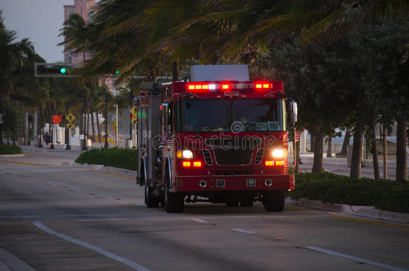 Fire truck with flashing emergency lights at dusk royalty free stock photo