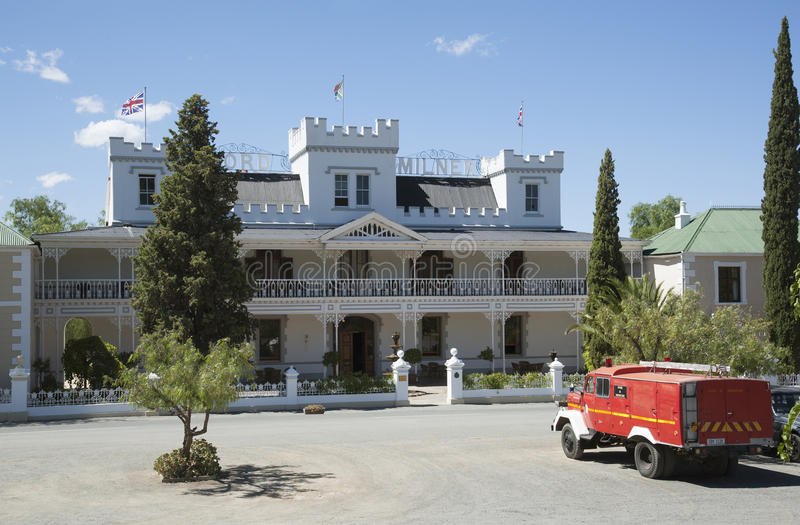 Fire truck and hotel in Matjiesfontein South Africa. Matjiesfontein in the Central Karoo region of the Western cape South Africa. Fire truck waiting outside the stock images