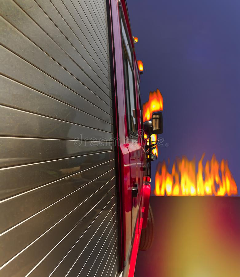 Fire Truck . Isolated. Fire truck shot from side of vehicle with fire straight ahead stock photography