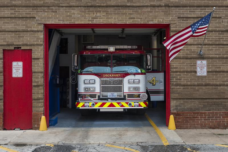 Fire Truck in its garage in the Lockhart Fire Department in the city of Lockhart, Texas. Lockhart, Texas - June 6, 2014: A Fire Truck in its garage in the royalty free stock images