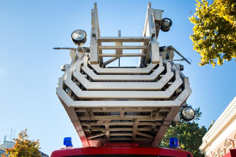 Fire truck ladder in folded state. Fire truck ladder in folded state close-up against a blue sky stock photo