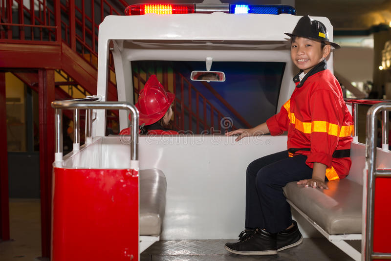 Fire truck. Little firefighters in the fire truck royalty free stock image