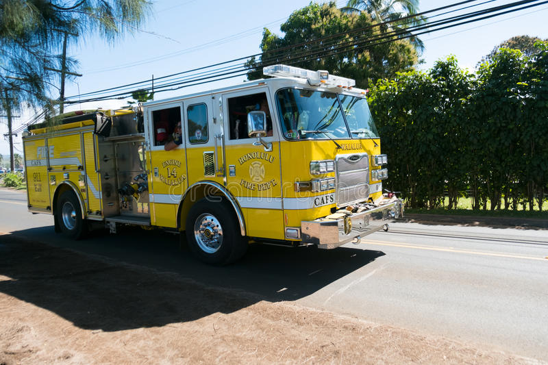 Fire Truck in Oahu Hawaii. HALEIWA, OAHU, HAWAII - FEBRUARY 15, 2017: Honolulu Fire Department heads back to the station after responding to a vehicle vs royalty free stock images