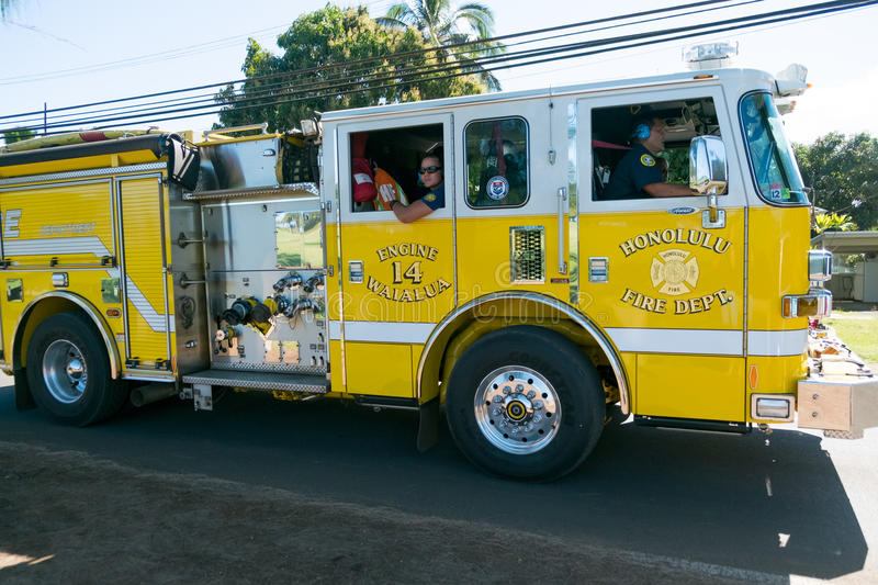 Fire Truck in Oahu Hawaii. HALEIWA, OAHU, HAWAII - FEBRUARY 15, 2017: Honolulu Fire Department heads back to the station after responding to a vehicle vs royalty free stock image