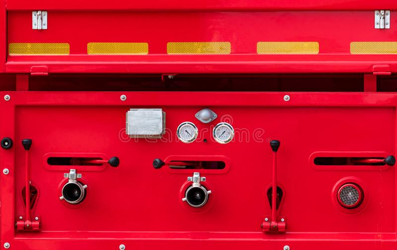 Fire truck. Rescue engine. Side view of red firetruck vehicle. Fire department truck. High pressure fire safety pump, gauge stock images