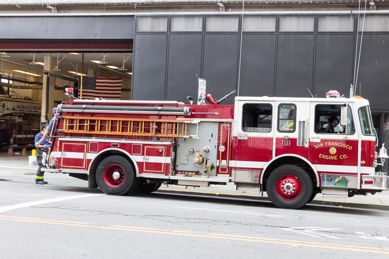 Fire truck at San Francisco firehouse. San Francisco, California, USA - September 13th, 2017: Fire truck on the street at the San Francisco Fire Department stock photography