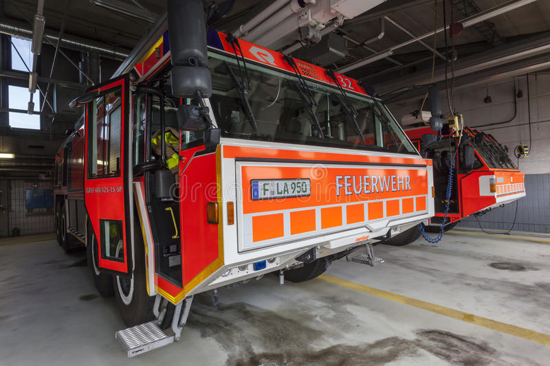 Fire Trucks at the Airport. FRANKFURT, GERMANY - JULY 24, 2016: Modern fire trucks at the airport Fire Department in Frankfurt Main International Airport royalty free stock images