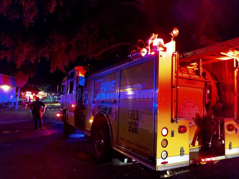 Fire Trucks lights flash on College Campus as they put out fire at night royalty free stock image