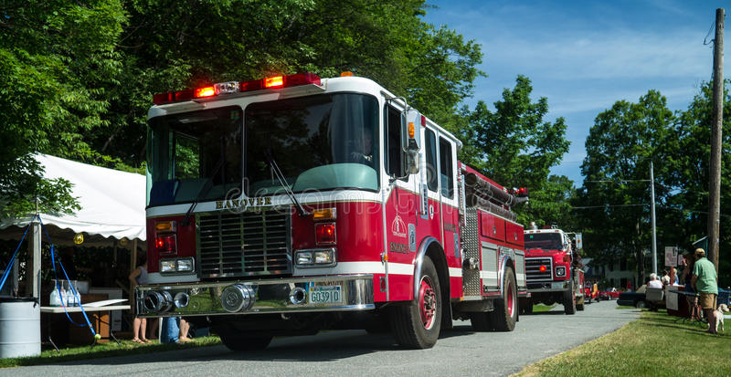 Fire Trucks in a Small Town Parade. Local fire trucks in the procession of a small old fashioned New England town parade stock photos