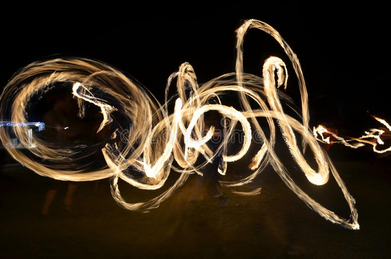 Fire-twirling artistic Long Exposure. Long exposure fire-twirling. Night activity spinning fire stock image