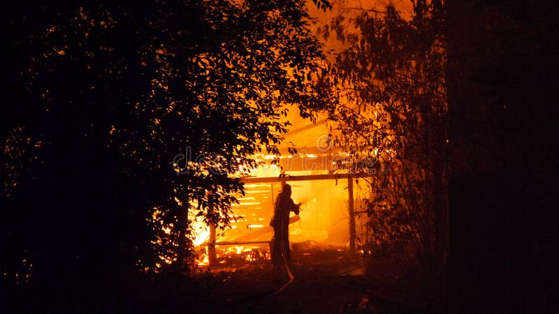 Fire village house at night. A big fire swept through the whole building.  royalty free stock photos