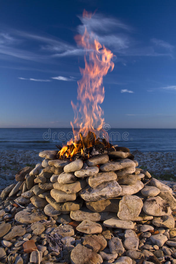 Fire and Water. Fire burning on the sea in summer. Fire and Water royalty free stock images