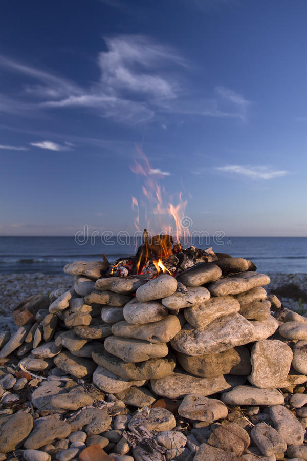 Fire and Water. Fire burning on the sea in summer. Fire and Water stock photography