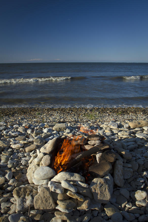 Fire and Water. Fire burning on the sea in summer. Fire and Water royalty free stock photo