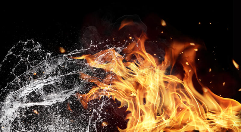 Fire and water elements on black background. Symbol of water and fire energy, isolated on black background royalty free stock photos
