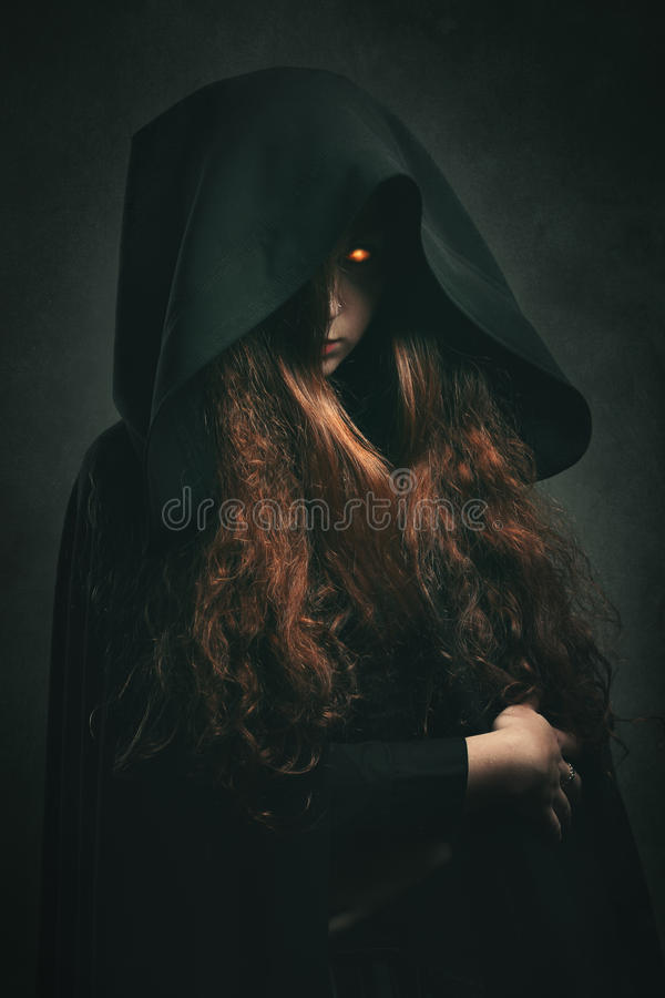 Fire witch with black robe royalty free stock images
