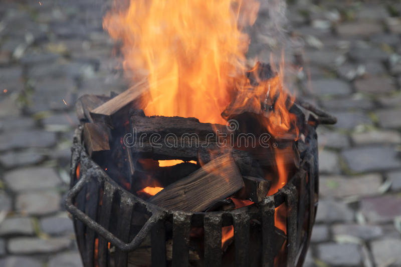 Fire wood in basket barrel royalty free stock photos