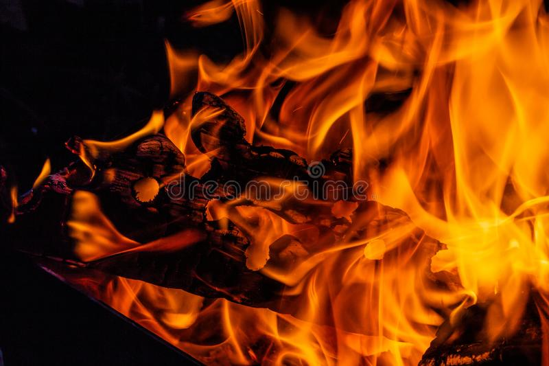 Fire. Wood burning in the fire. Orange flame. Tongue of flame stock photography