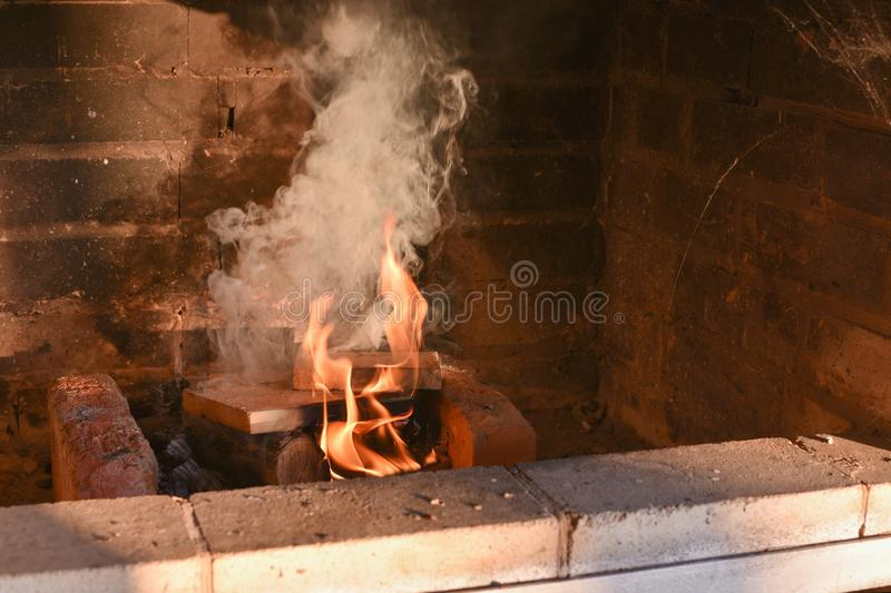Fire wood burning in the oven. Fire wood burning in the oven. Fire wood burning in the oven. Fire in a stone stove. The stove on the street. Preparing for the stock photography