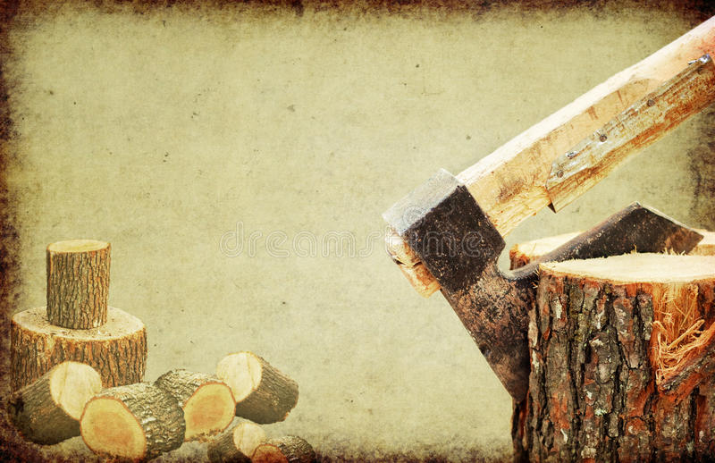 Fire wood concept.Axe chopping log stock photography
