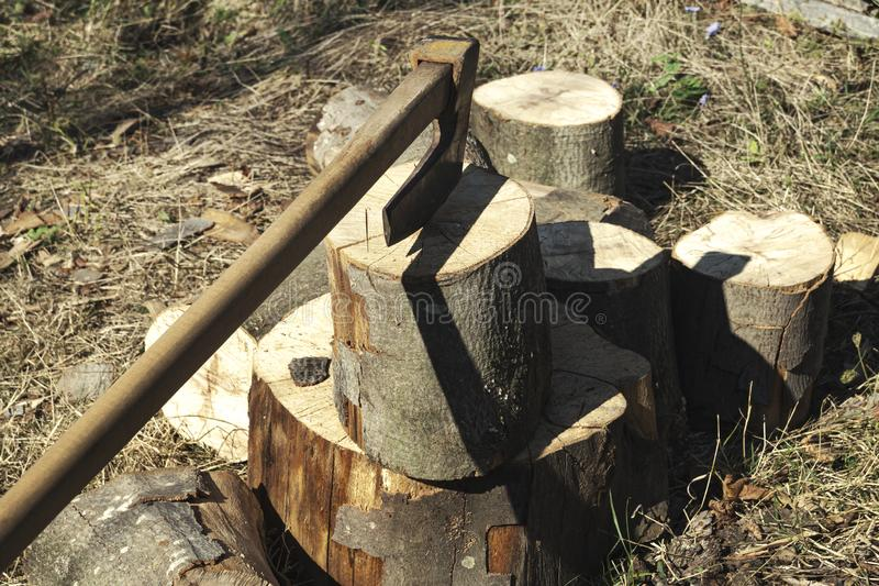 Fire wood and old axe. Renewable resource of a energy royalty free stock image