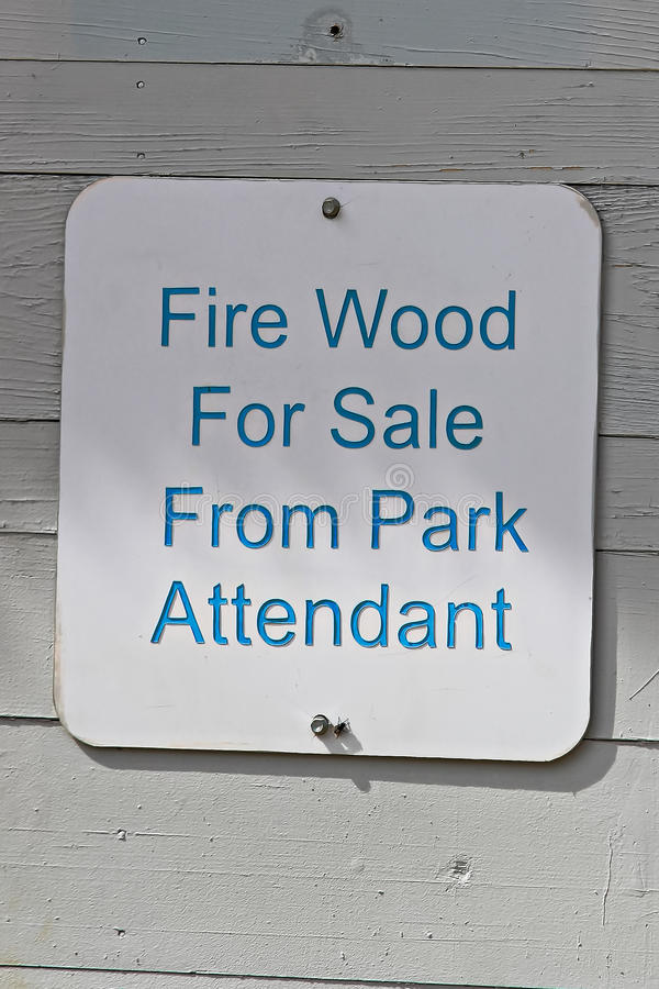 A fire wood for sale from park attendant sign.  stock image