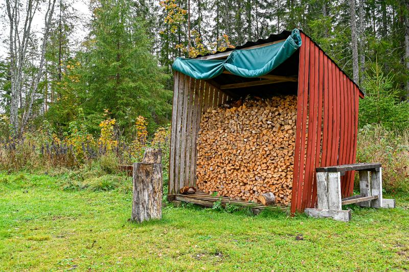 Fire wood stacked in a little shelter royalty free stock images