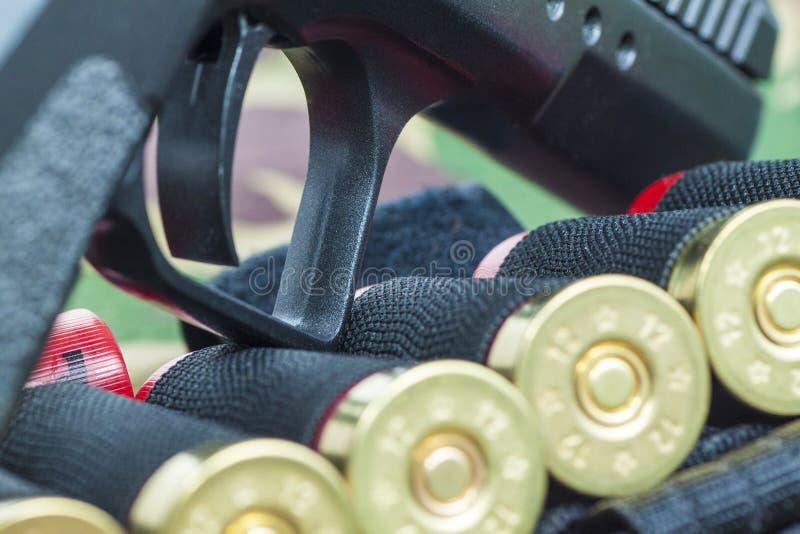 Firearm Pistol on military camouflage background. Firearm Pistol Clip And Hand Gun Ammunition on military camouflage background royalty free stock image