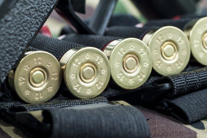 Firearm Pistol on military camouflage background. Firearm Pistol Clip And Hand Gun Ammunition on military camouflage background royalty free stock photos