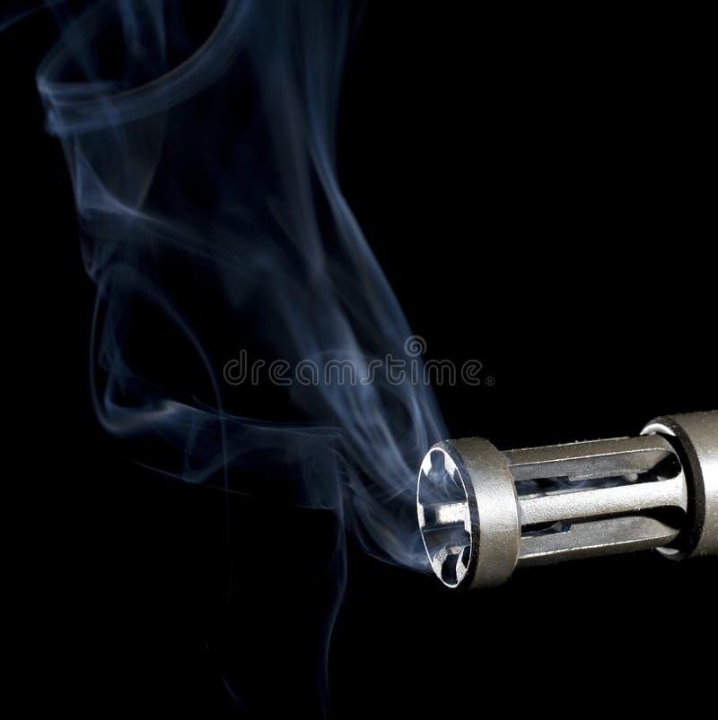 Firearm smoke clearing stock photography