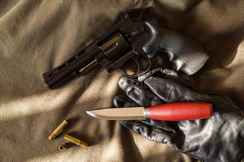 Firearms and edged weapons. Knife and gun stock photos