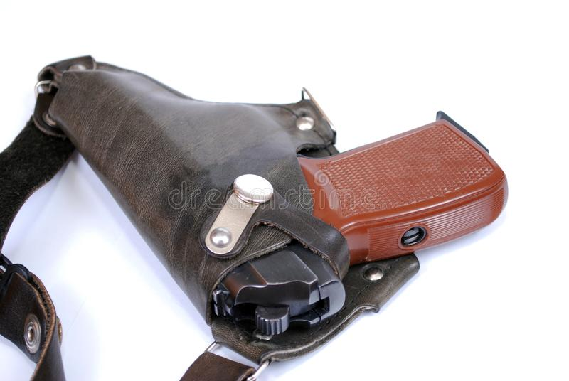 Firearms of limited defeat a service pistol in a leather holster on a white background. It is isolated stock images