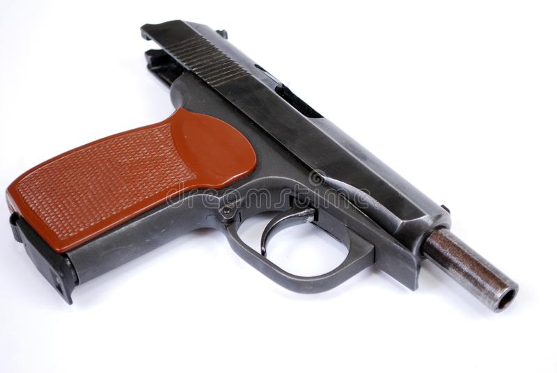 Firearms of limited defeat the service pistol rose on a barrier delay. It is isolated royalty free stock photos