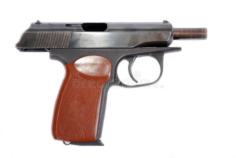 Firearms of limited defeat the service pistol rose on a barrier delay. It is isolated royalty free stock images