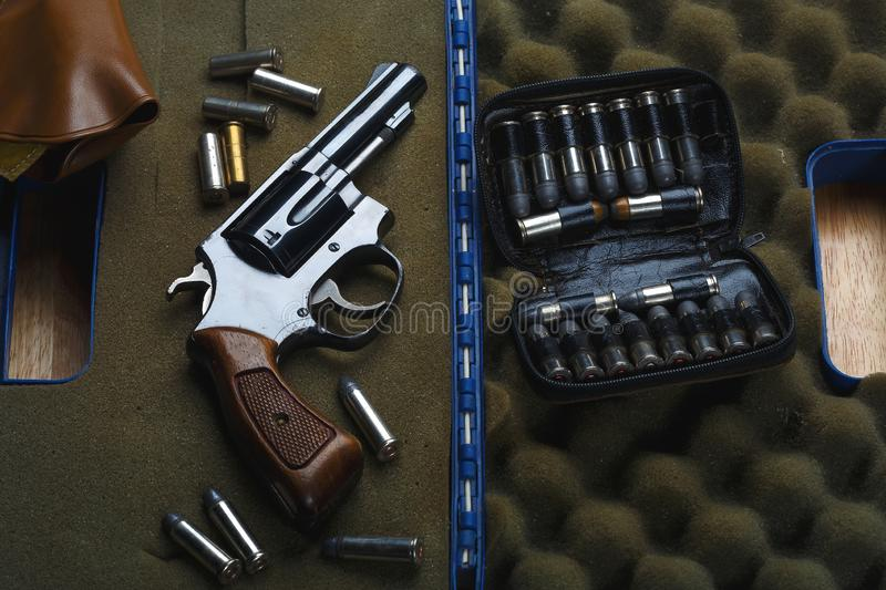 Firearms Revolver,Old revolver, .38 gun and ammunition,conceal gun with bullet home protection concept. Firearms Revolver,Old revolver, .38 gun and ammunition stock photography
