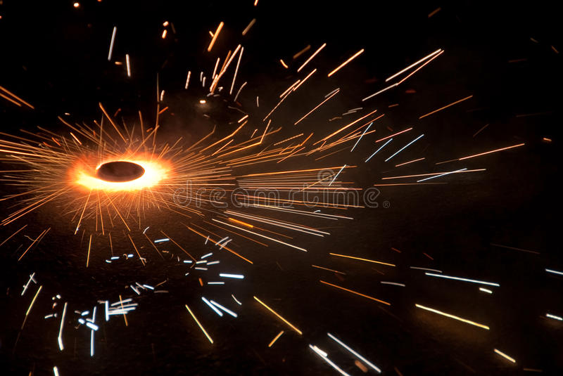 Firecracker. A spinning firecracker and sparklers royalty free stock photos