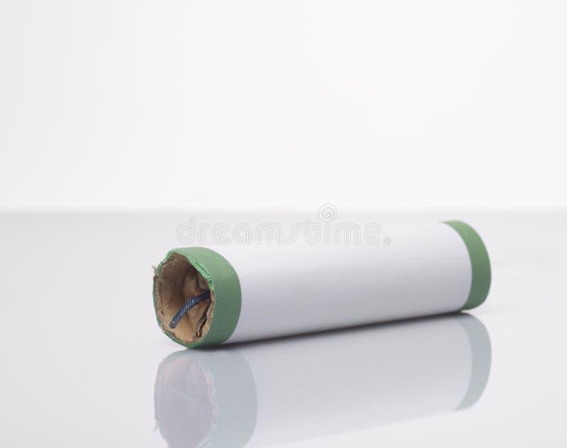 Firecracker. A firecracker on a white surface, on white studio background stock photos