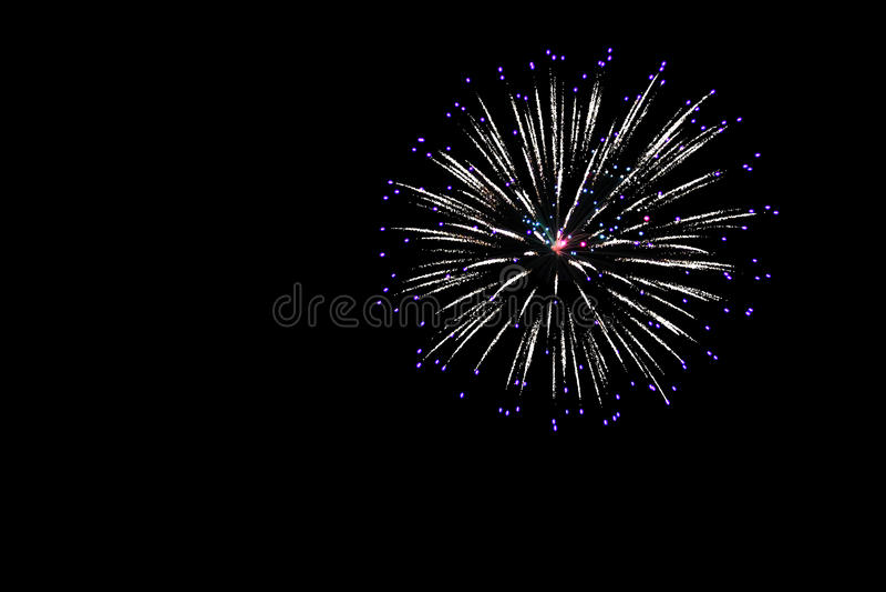 Firecracker. Single firecracker exploding in the darkness stock photo