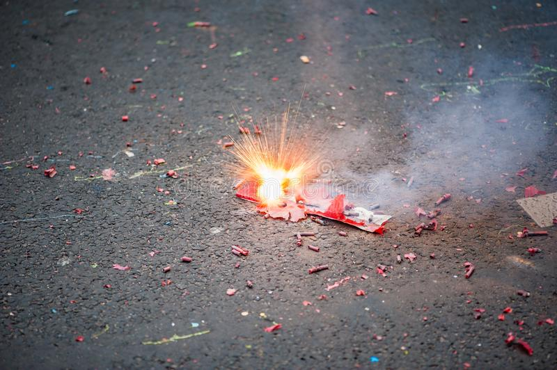 Firecracker exploding in the street. For the chinese new year celebration stock image